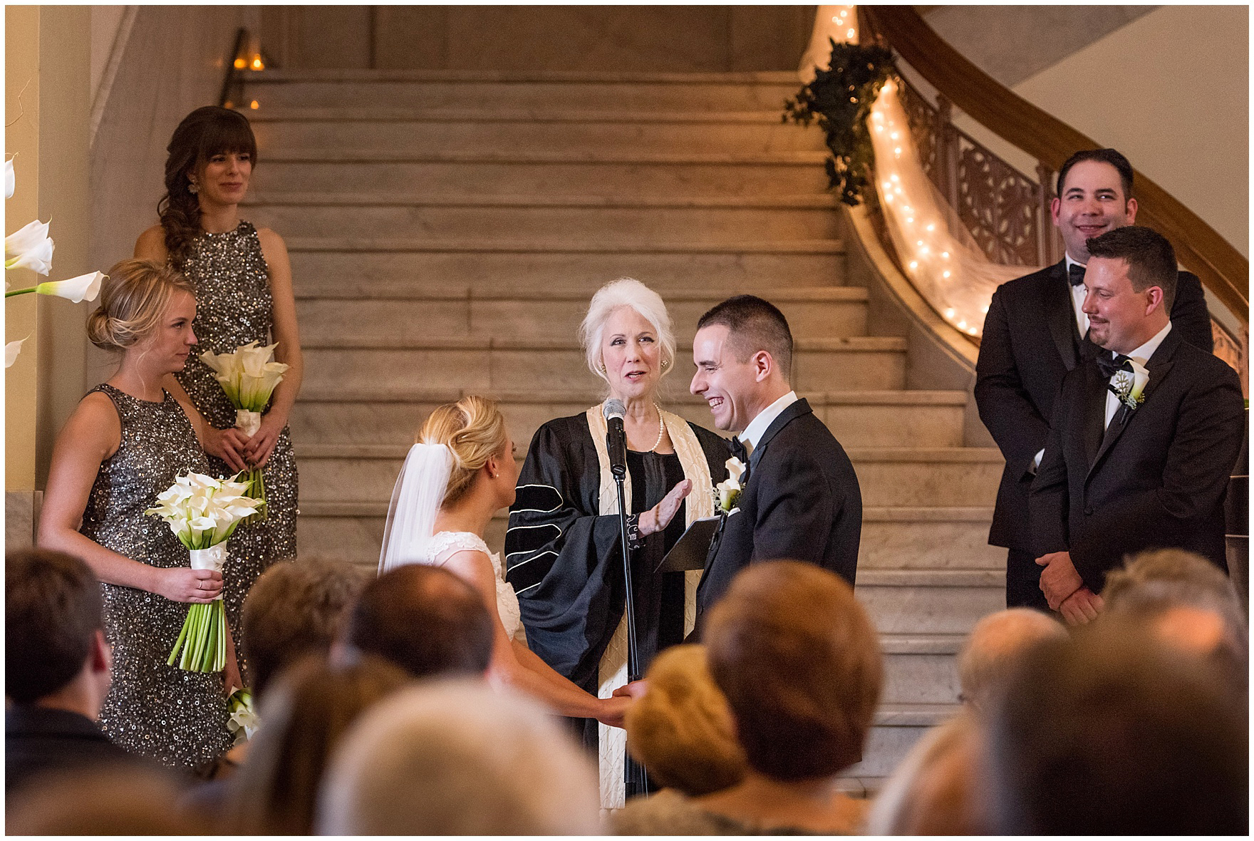 The bride and groom hold hands during a Newberry Library Chicago wedding.