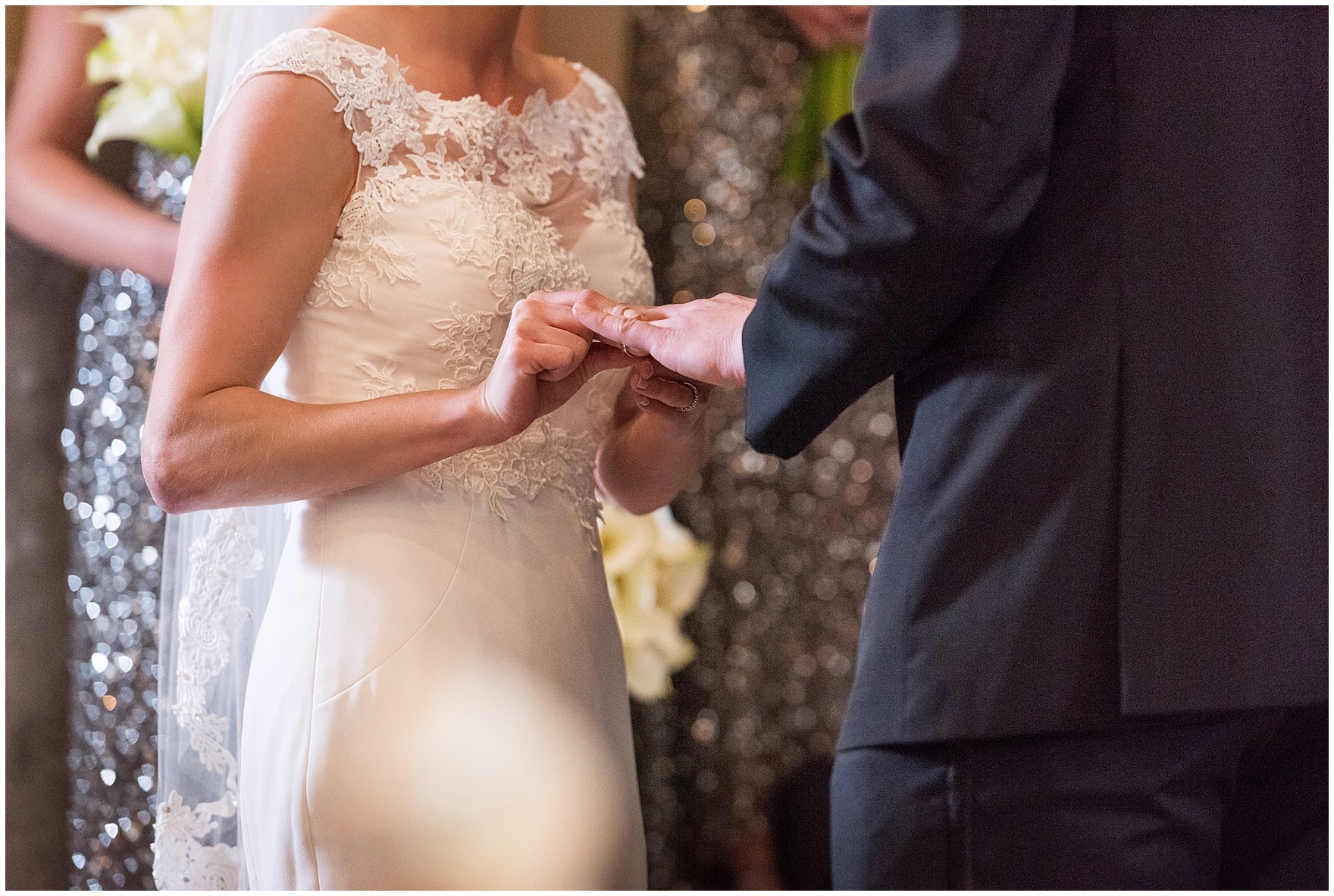 The bride and groom exchange rings during a Newberry Library Chicago wedding.