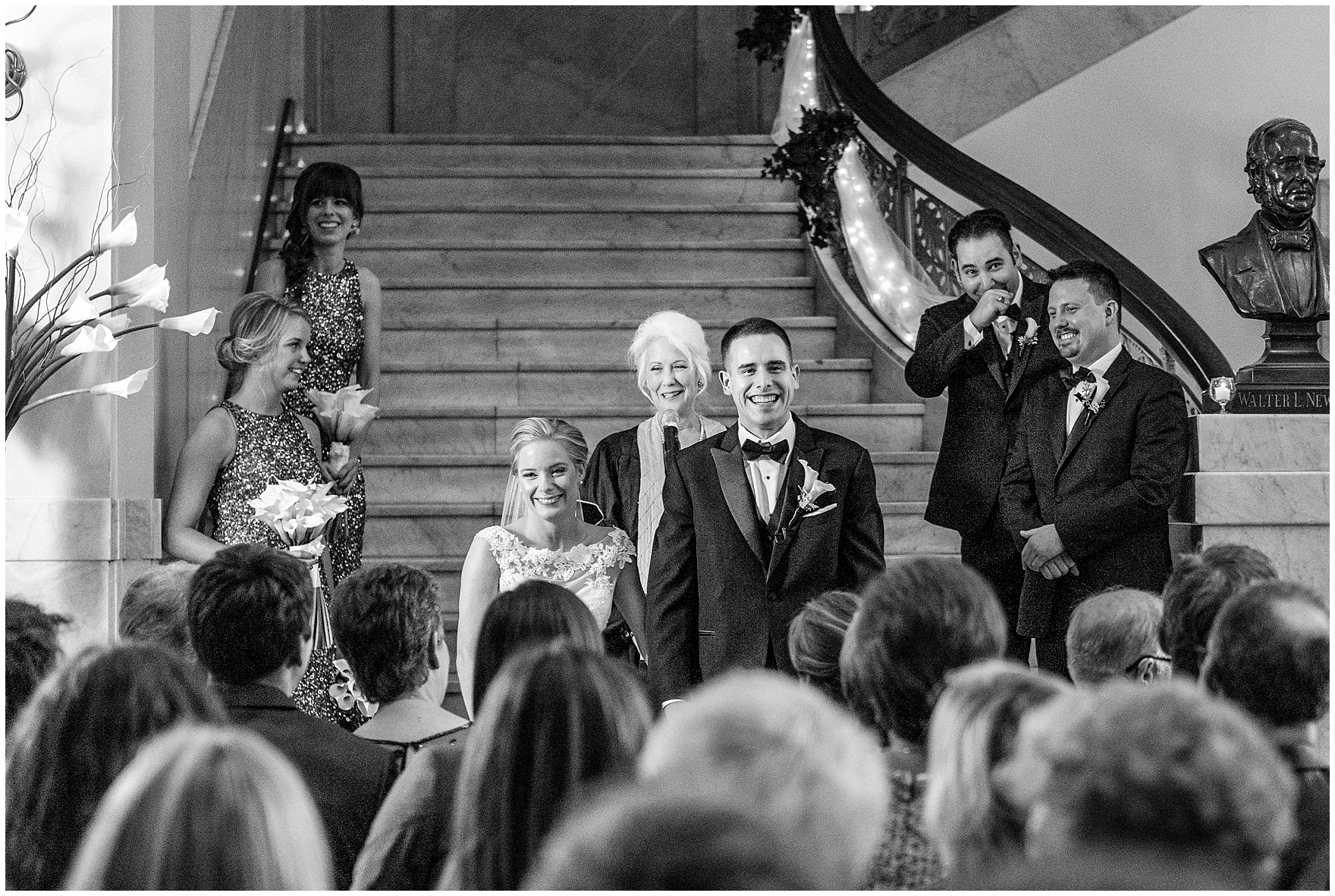 The bride and groom smile at their guests during a Newberry Library Chicago wedding.
