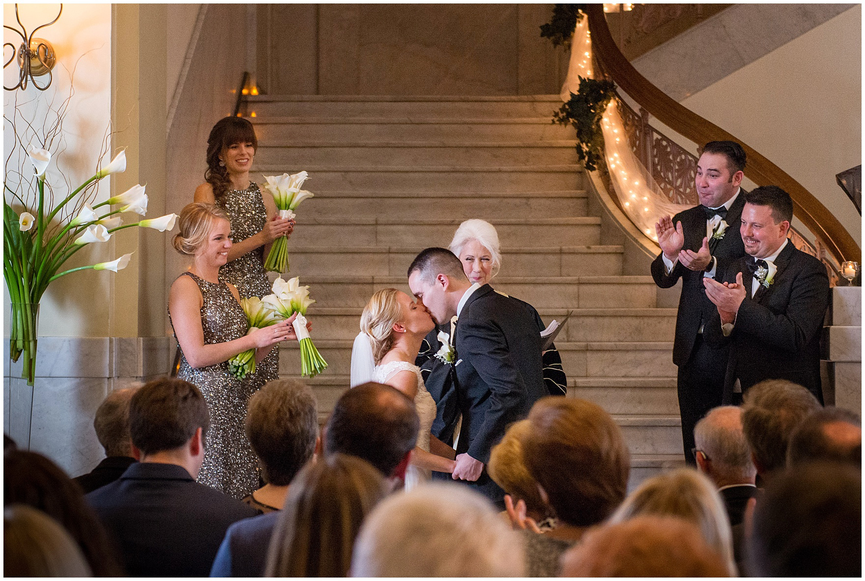 The bride and groom kiss during a Newberry Library Chicago wedding.