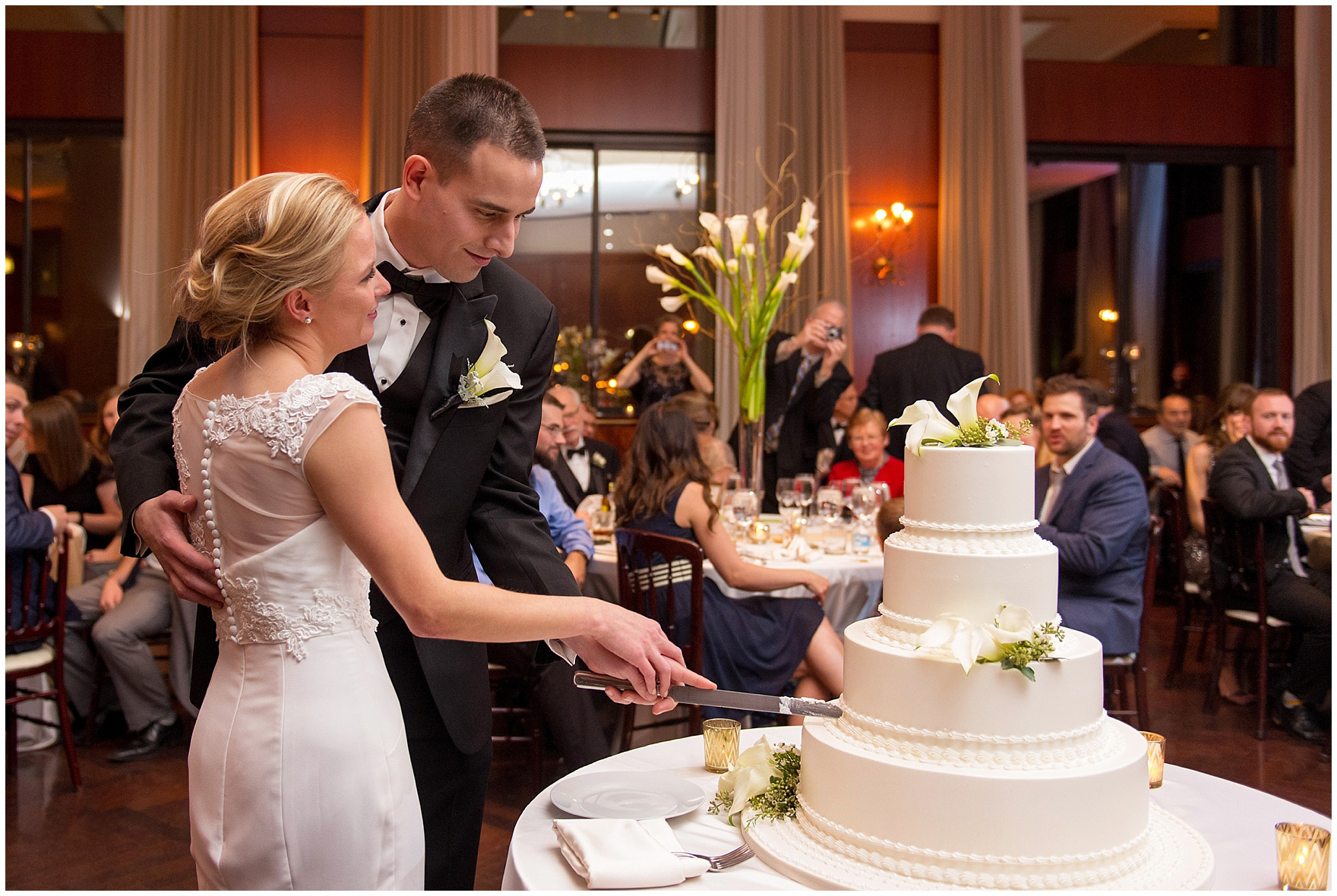 The bride and groom cut their cake during a Newberry Library Chicago wedding reception.
