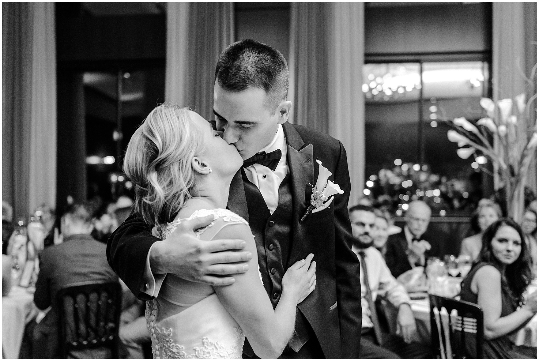 The bride and groom kiss during a Newberry Library Chicago wedding reception.