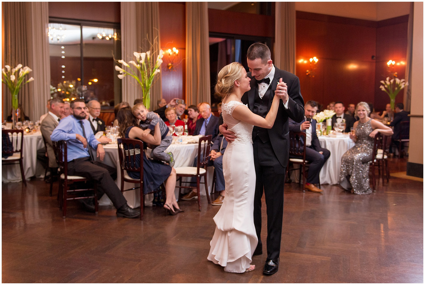 The bride and groom dance during a Newberry Library Chicago wedding reception.