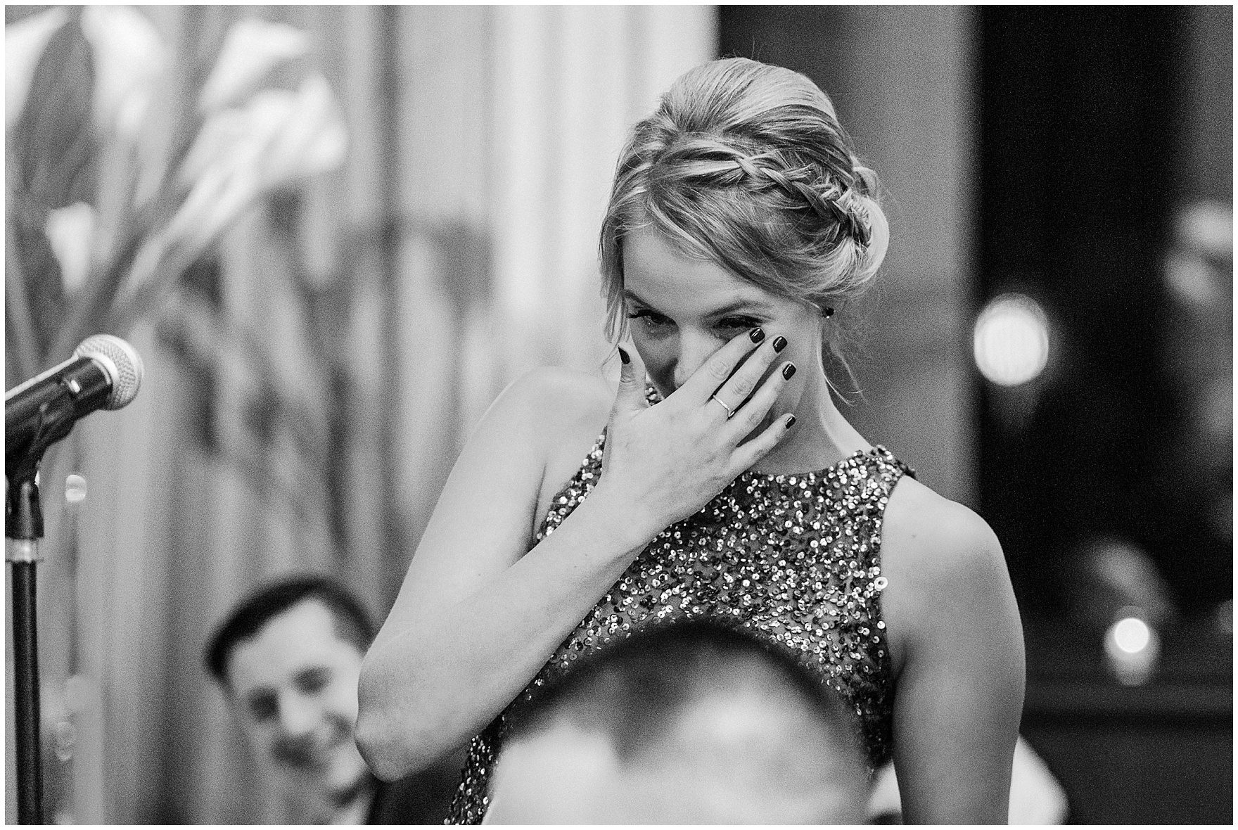 The maid of honor gets teary during a Newberry Library Chicago wedding reception.