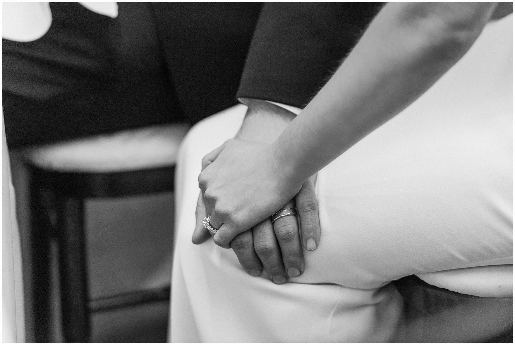 The bride and groom hold hands during a Newberry Library Chicago wedding reception.